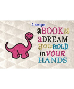 dinosaur applique with a book is a dream