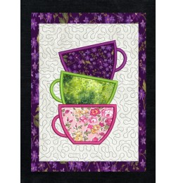 Tea cups applique stippling in the hoop