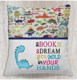 Dinosaur Baby with a book is a dream
