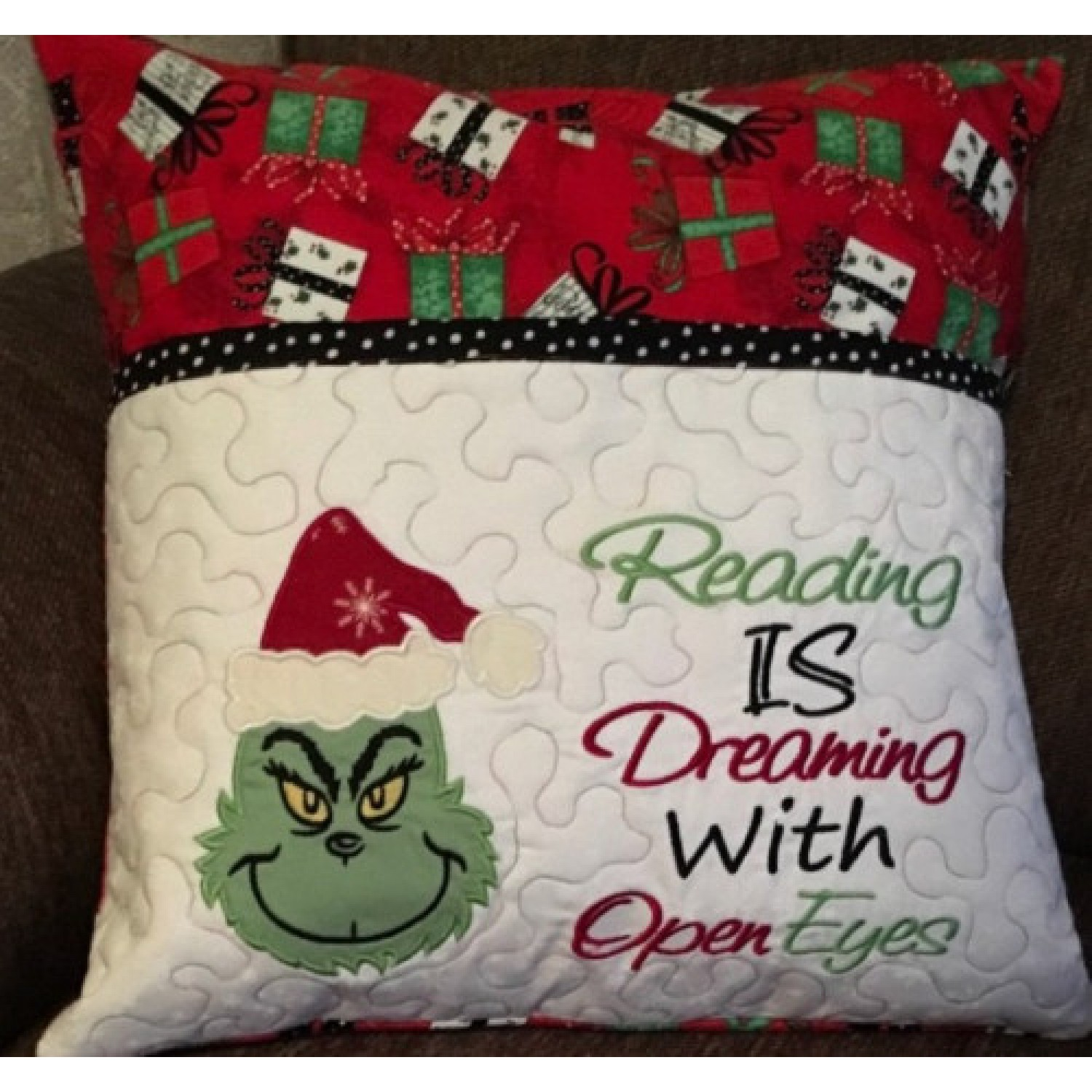 Grinch face with reading is dreaming designs